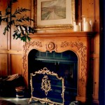 Pine paneling with a folk country french mantel -  robert madsen design