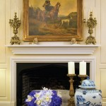 traditional mantel candelabras and large painting