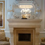 Traditional simple fireplace with venetian mirror
