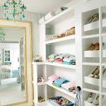 White closet with blue chandelier