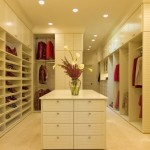 White on White walk in Closet with island